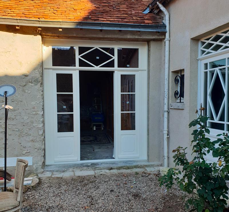 Porte extérieure en bois coloris blanc